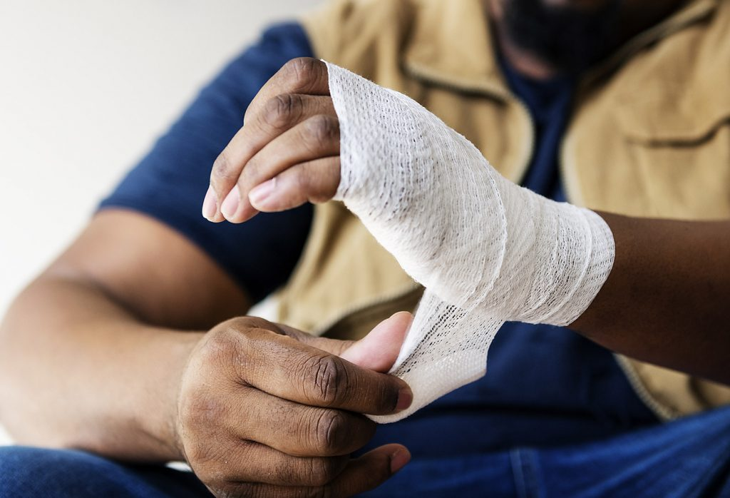Man Wrapping Injured Hand After Construction Injury